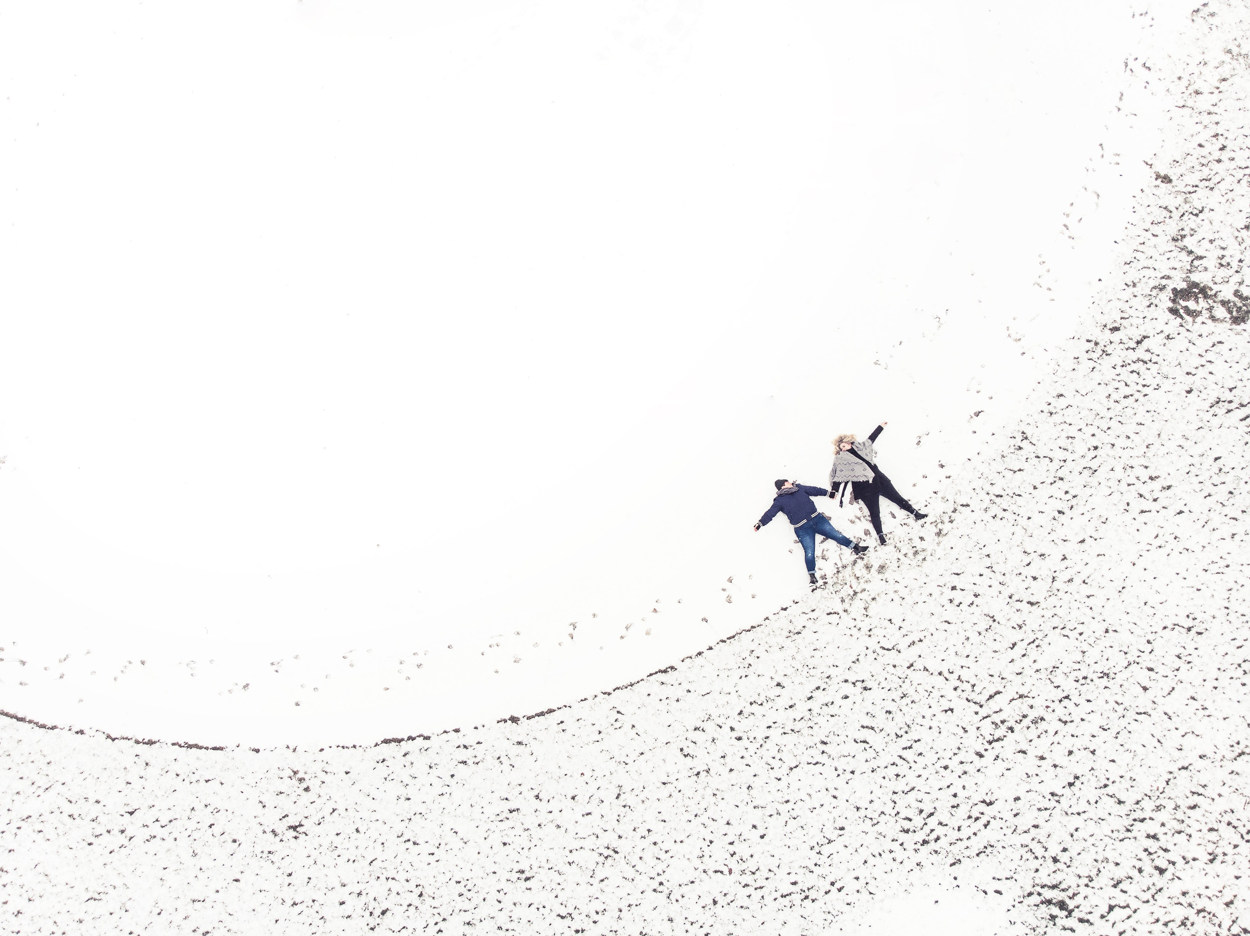 two-women-making-snow-angels_Photo by Samantha Hurley from Burst